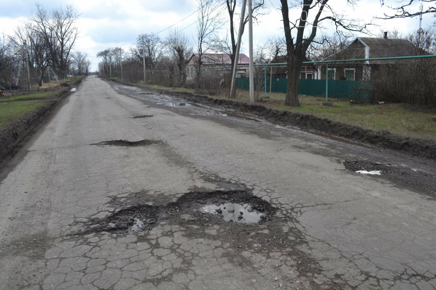 Попал в яму — сам виноват: копы составили протокол на водителя из Покровска, который, въехав в яму, повредил авто, фото-22