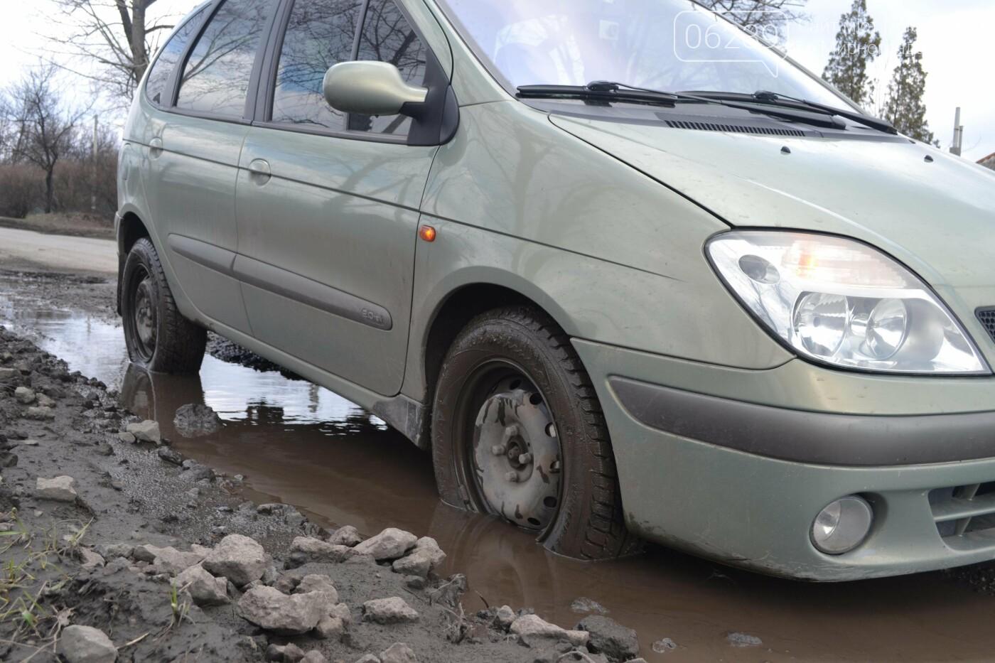 Попал в яму — сам виноват: копы составили протокол на водителя из Покровска, который, въехав в яму, повредил авто, фото-30